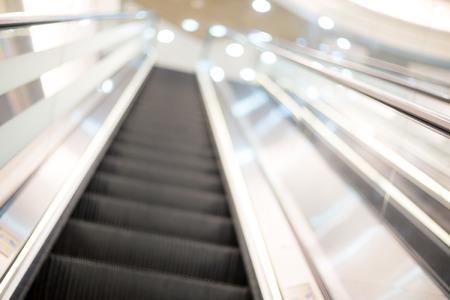 go inside: Blurred image of escalator Stock Photo