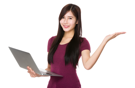 palm computer: Asian woman use of the laptop computer and open hand palm