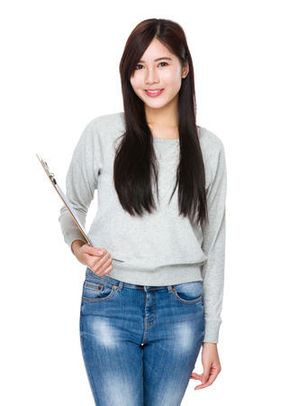 sweatsuit: Asian Young Woman hold with clipboard Stock Photo