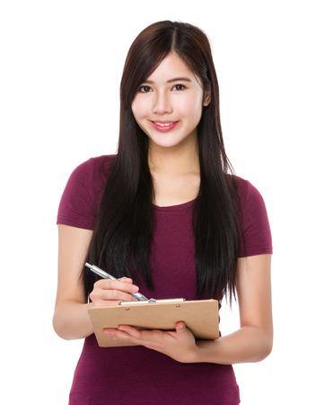 casual wear: Asian Woman take note on clipboard