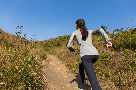 go for: Young Woman go for running at mountain