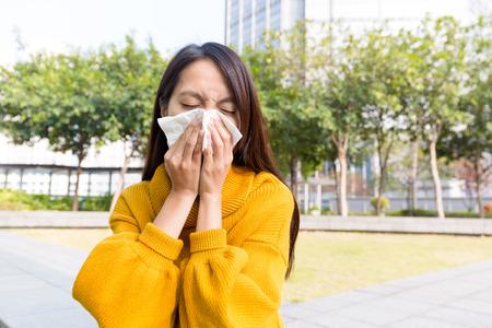 Asian Woman sneezing Stock Photo