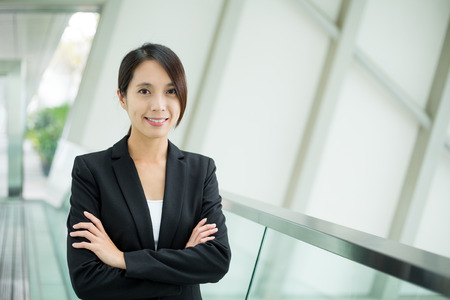 common room: Businesswoman at office Stock Photo