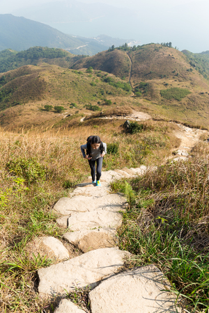 go for: Asian Woman go for hiking at mountain Stock Photo