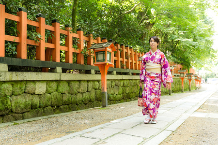 ancient pass: Young Woman wearing the kimono dress and walking the street