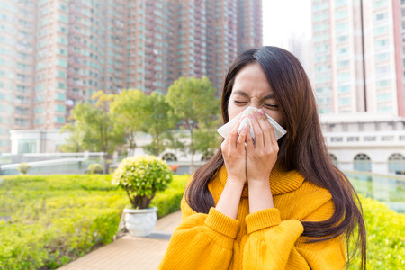 runny: Young Woman runny nose Stock Photo