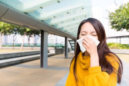 sneezing: Woman sneezing Stock Photo