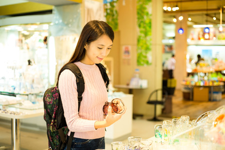 lifestyle shopping: Woman holding a cup in a shop