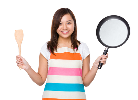 japanese cookery: Housewife holding up with frying pan and wooden ladle