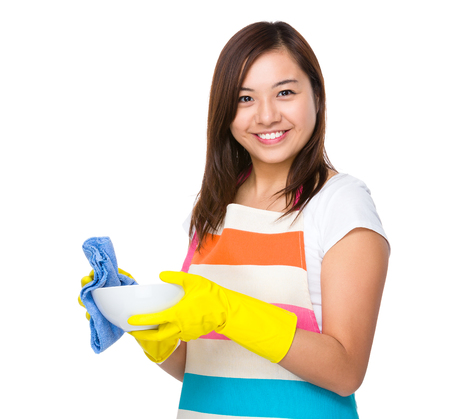 japanese cookery: Asian housewife washing dishes with rag Stock Photo