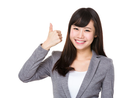 chinese adult: Asian Young businesswoman showing htumb up gesture