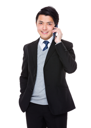 phone calls: Asian Young Businessman talk to cellphone Stock Photo