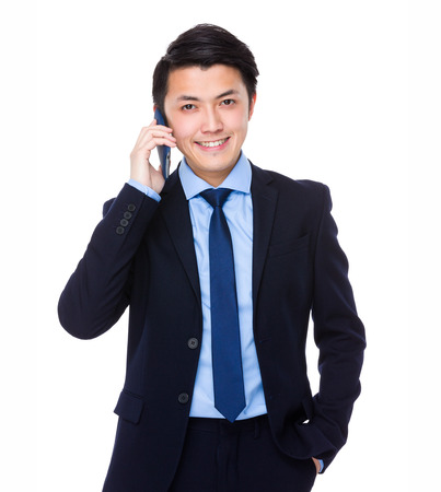 phone calls: Businessman talk to cellphone