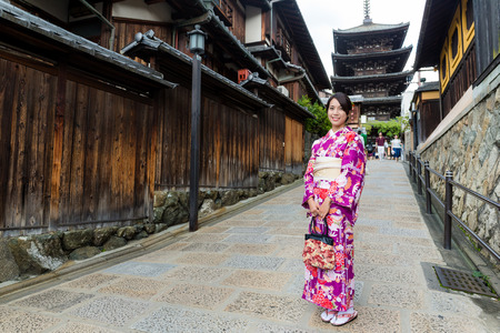 chinese pagoda: Young woman wearing kimono at yasaka pagoda