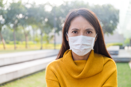 deterrence: Asian woman wearing a face mask Stock Photo