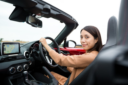 cabriolet: Woman driving a cabriolet car