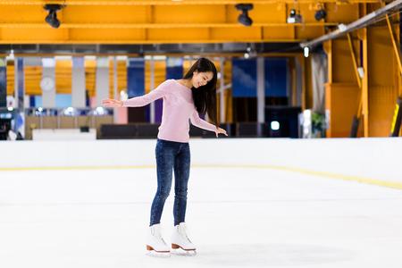 skating rink: Woman on skating rink