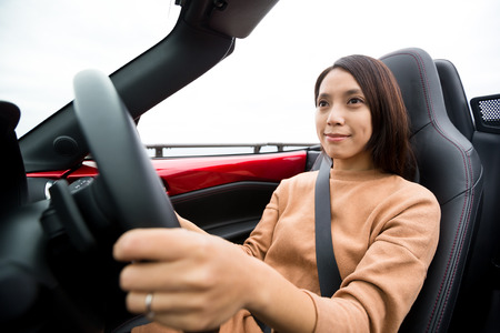 cabriolet: Young woman driving cabriolet Stock Photo