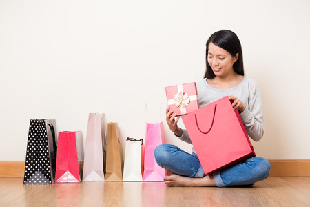 gift bags: Asian Young Woman take out the gift box from shopping bag
