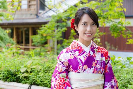 asian house plants: Young Woman wearing japanese kimono