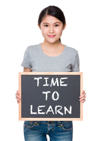 causal: Woman hold with chalkboard and showing phrase time to learn
