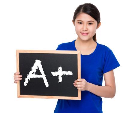school exam: Asian student show with blackboard A plus mark Stock Photo
