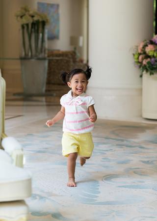 Happy girl running Stock Photo