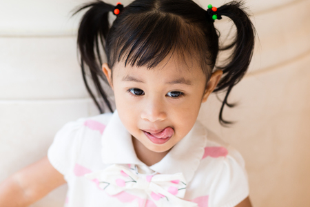 Little girl showing tongue