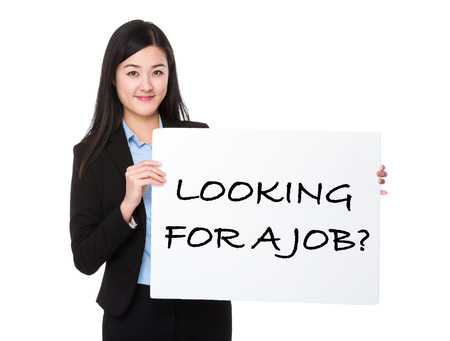 looking for a job: Asian businesswoman holding a board showing with looking for a job phrases