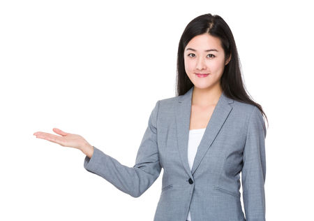 gente adulta: Asian Businesswoman with open hand palm