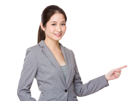 confident business woman: Asian young Businesswoman with finger point up