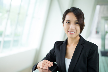 building planners: Young Businesswoman at office Stock Photo
