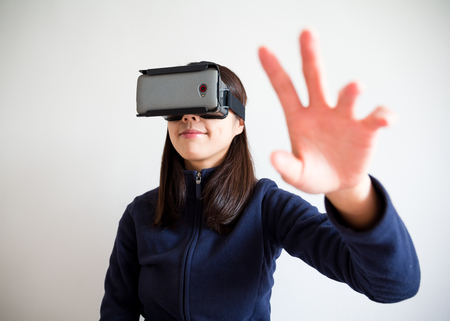 virtual reality simulator: Woman hand raised up and touch something Stock Photo