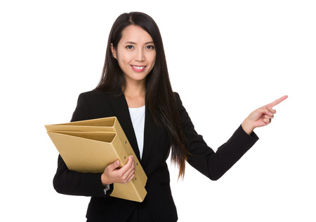 show cases: Businesswoman hold with folder and finger point up Stock Photo