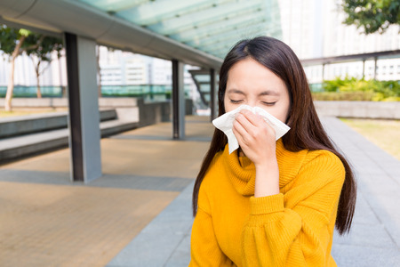 runny: Asian woman runny nose