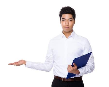 business service: Businessman hold with clipboard and open hand palm