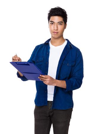 iranian: Chinese mixed iranian man write on the file board
