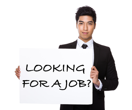 business for the middle: Asian businessman showing a placard showing with looking for a job phrases