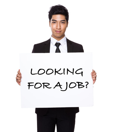 business for the middle: Businessman hold with white card board presenting phrase of looking for a job