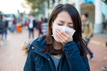 deterrence: Woman feeling unwell at outdoor Stock Photo