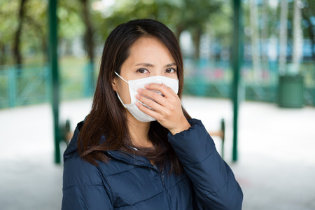 deterrence: Woman wearing face mask to protect against disease