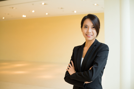 building planners: Young Businesswoman standing at office Stock Photo
