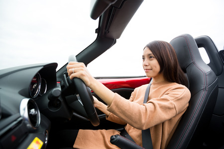 convertible: Young woman in convertible car