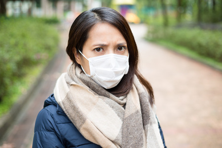 facemask: Woman wear facemask outdoor Stock Photo