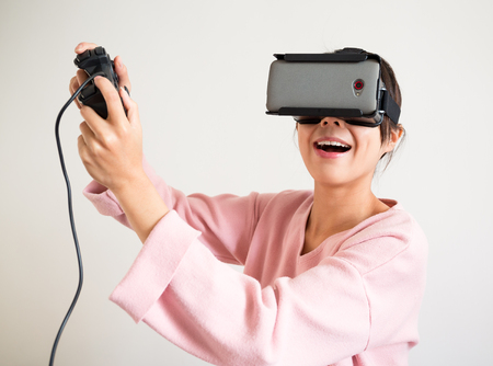 excite: Excite Woman in virtual reality glasses playing the game