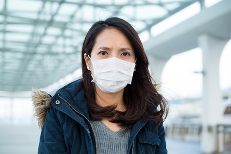 deterrence: Woman wearing mask at Outdoor Stock Photo