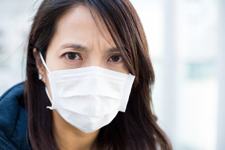 deterrence: Woman wearing face mask for protection