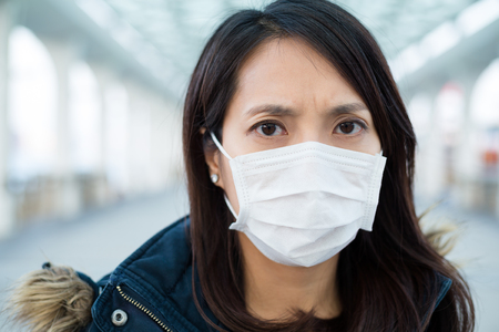 deterrence: Woman wearing medical mask at outdoor Stock Photo