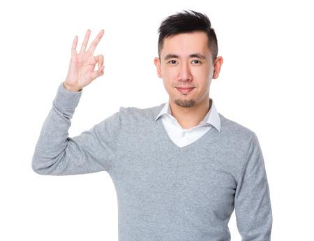 ok hand: Businessman with ok sign gesture