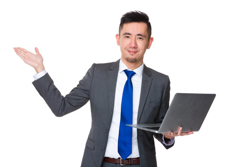 palm computer: Asian Young Businessman hold with laptop computer and open hand palm Stock Photo